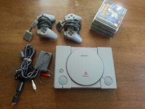 Sony Playstation 1 with several games, 2 controllers, cords +