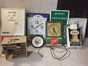 ADVERTISEMENT SIGNAGE AND CLOCKS