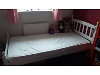 Single bed white with new matress.