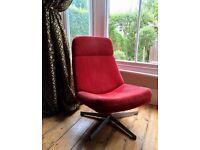 Red retro style Swiss swivel chair