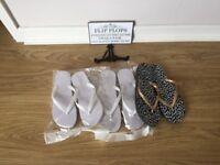 Wedding flip flops and sign
