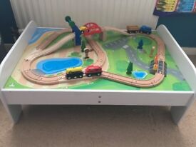 Children's train table completed with track and trains,a car and accessories