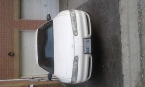 2002 Oldsmobile Intrigue White Sedan