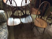 Ercol Extending Table and four Swan Back Chairs