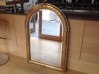 Deknudt ( Belgian) Gold leaf arch mirror. Bevel led glass, solid. Size is 42.5 by 29 inches