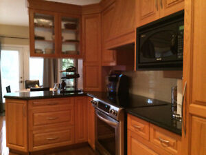 Solid Oak Kitchen Cabinets, Granite Counters & Sub-Zero Fridge