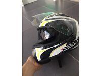 Brand new motorbike helmet with sun visor
