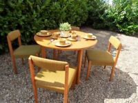 Genuine 1960s Vintage round wooden Dining Table & 4 green Upholsteredchairs