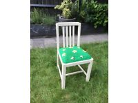 White dining chair with cushioned seat