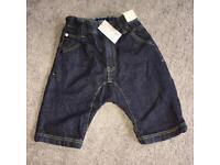 Brand New girls NEXT dark blue denim shorts (age 6)