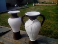 Two indoor or outdoor cream and brown, large stone vases.