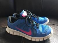 Girls Nike free 5.0 trainers size 13.5