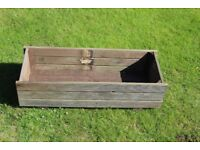 Wooden garden planter made from reclaimed picket fence