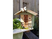 Lovely selection of bespoke bird boxes, bug hotels and butterfly houses