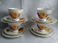 4 ROYAL STAFFORD RED AND YELLOW DAHLIA TEA CUPS, TEA PLATES AND SAUCERS TRIOS
