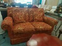 Red and gold fabric 2 seater sofa
