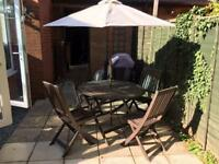 4 piece table and chairs with parasol.