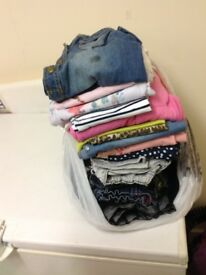 Bag of teen girls clothes