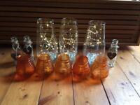 Fairy lights in vases, tea light holders, small flower vases