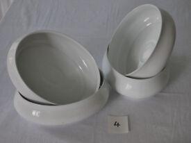 Four white porcelain serving dishes
