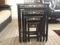 Nest of 4 oriental tables finished in black lacquer & coloured design.