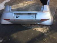 Mitsubishi colt rear bumper in silver colour covers 2003-2007 models.