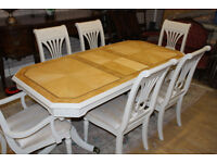 beautiful shabby chic extanding table with six beautiful chairs