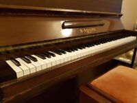 Upright piano and storage stool in good condition