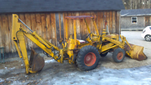 WANTED BLOWN UP BACKHOE