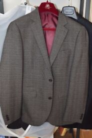 Next man's suit immaculate condition never worn. 40 inch chest 32 inch waist