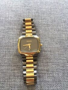 """Nixon """"the player"""" watch for sale, gold and gunmetal"""