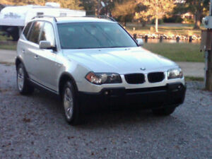 05 Quebec plated BMW X3 SUV