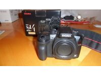 Sigma SD14 14mp camera with 4 lenses and a dedicated flashgun