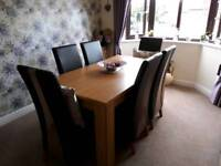 Oak finish dining table with 6 high back chairs