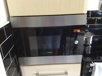Zanussi built in microwave 12 months old cost £369 Excellent condition