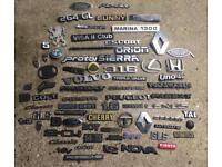 Collection of car badges Lotus, Porsche, Austin, Ford