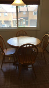 Wooden dinning room table with four chair