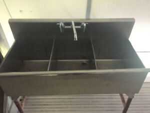 Stainless steel sinks with taps