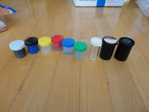 Lot of assorted plastic containers and bottles for paint storage