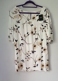 Floral cream shirt size 16. Brand new.