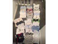 Various baby vests and baby grows