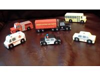 Wooden American toy vehicles, fire engine, police car, ambulance, taxi, truck, school bus