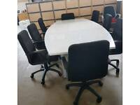 New ex warehouse boardroom conference meeting table in white gloss with 8 black swivel chairs.