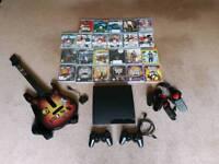 Playstation 3 Slim 160gb console in black mega bundle