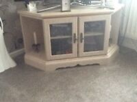 TV Unit in light wood with glass door front with shelf