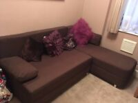 Hardly used sofa-bed in purple-brown colour