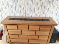 Solid wood unit with black glass top