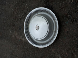 4 15 inch Cadillac hubcaps