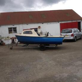 14 ft witth boat galvanised trailer and outboard
