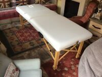 Very well made therapy table in white on timber frame